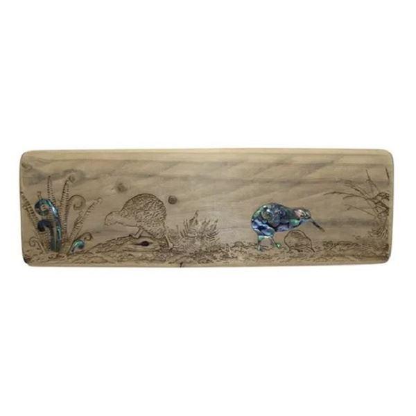 Picture of Paua kiwis driftwood